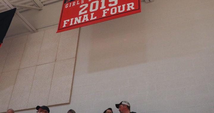 Kingston girls get win, raise banner