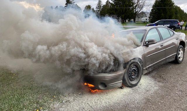 Samaritans notify motorist of car fire