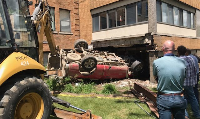 Man driving with young child crashes into Huron County medical facility, remains at large