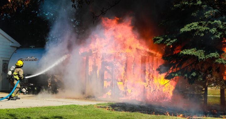 Fire destroys shed, camper