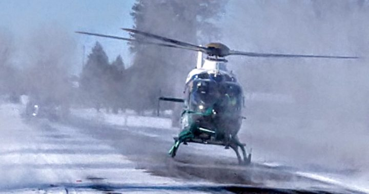 Helicopter transports crash victim freed by firefighters