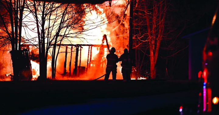 Fire destroys Caro garage