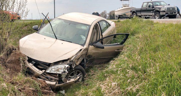 Caro driver hurt when her car strikes pickup